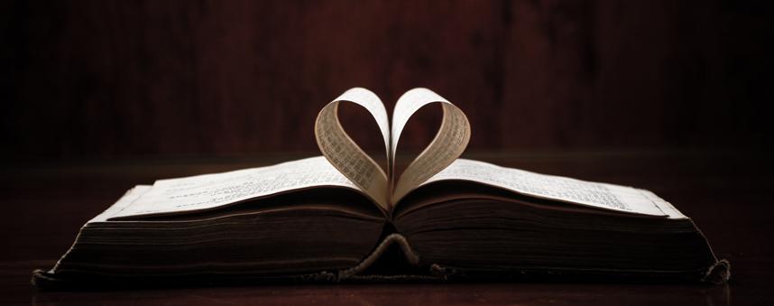Religious Book folded into a heart shape